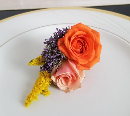 wonderfully whimsical boutonniere